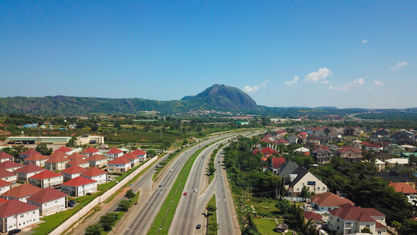 Abuja, Nigeria with Aso Rock - image by Tayvay/shutterstock.com