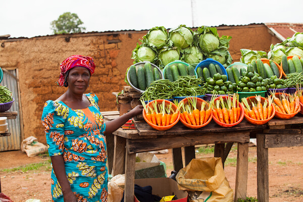 Nigerian farmer selling fruits and vegetables on the market