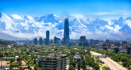 Santiago de Chile - capital city of Chile with Gran Torre building and snowy Andes mountains