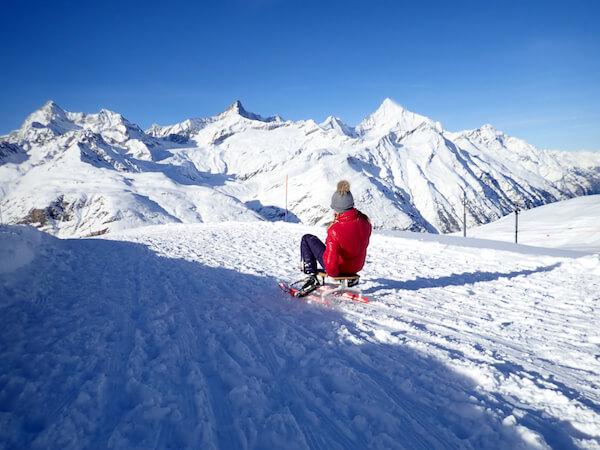 Girl in the Swiss mountains on Sledge - Taffpixture/shutterstock