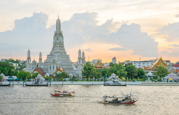 Wat Arun in Bangkok is a famous landmark of Thailand, here shown at sunset - shutterstock.com