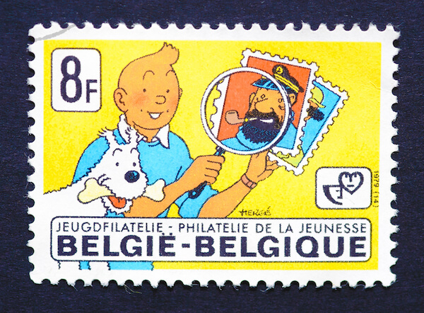 Stamp with Tintin, dog Snowy and Captain Haddock - image by Catwalker/shutterstock.com